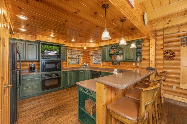 Breakfast bar for four with a kitchen at Lookout Lodge, a 5 bedroom cabin rental located in Pigeon Forge