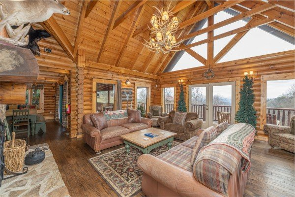 Living room with vaulted ceilings and mountain views at Lookout Lodge, a 5 bedroom cabin rental located in Pigeon Forge