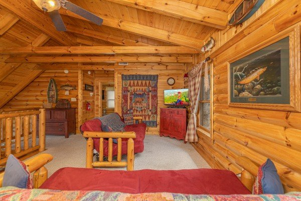 Futons and TV in a bedroom at Lookout Lodge, a 5 bedroom cabin rental located in Pigeon Forge