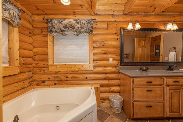 Jacuzzi tub and large vanity in a bathroom at Lookout Lodge, a 5 bedroom cabin rental located in Pigeon Forge