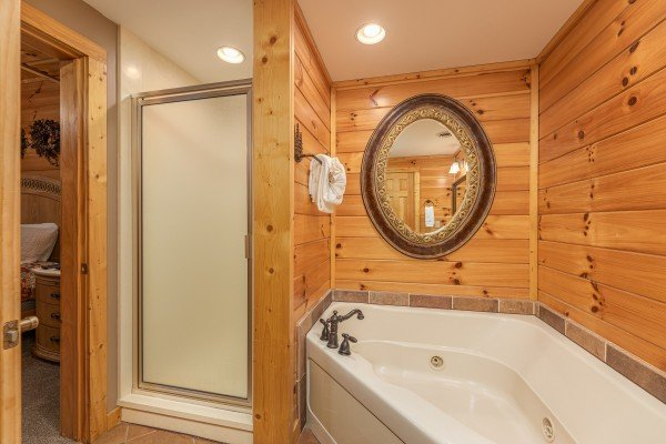 Corner jacuzzi and shower stall in a bathroom at Lookout Lodge, a 5 bedroom cabin rental located in Pigeon Forge