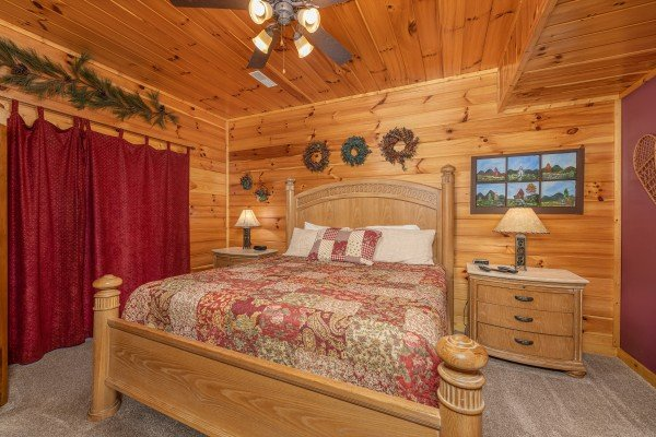 Bedroom with two night stands and two lamps at Lookout Lodge, a 5 bedroom cabin rental located in Pigeon Forge