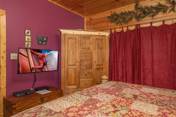 Armoire, chest, and TV in a bedroom at Lookout Lodge, a 5 bedroom cabin rental located in Pigeon Forge