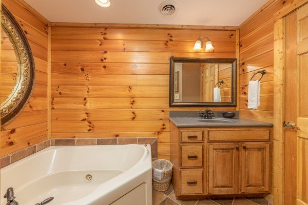 Bathroom with a jacuzzi and vanity at Lookout Lodge, a 5 bedroom cabin rental located in Pigeon Forge