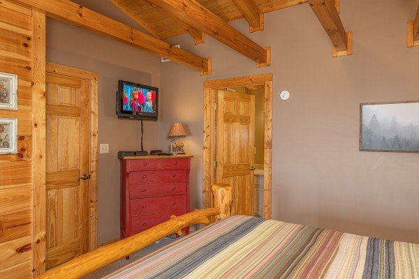 Dresser and TV in a bedroom at Lookout Lodge, a 5 bedroom cabin rental located in Pigeon Forge