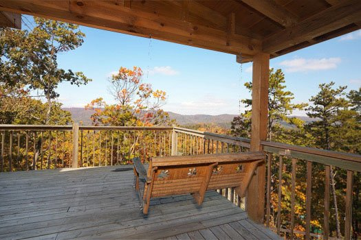 swing on deck with smoky mountain views at hooked on cowboys a 2 bedroom cabin rental located in pigeon forge
