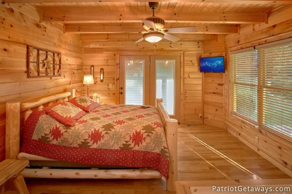 Log framed bed at Alpine Sundance Trail, a 3 bedroom cabin rental located in Pigeon Forge