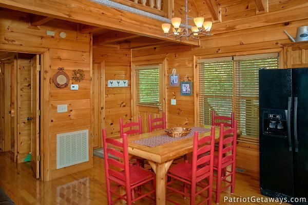 Dining area with table for six at Alpine Sundance Trail, a 3 bedroom cabin rental located in Pigeon Forge