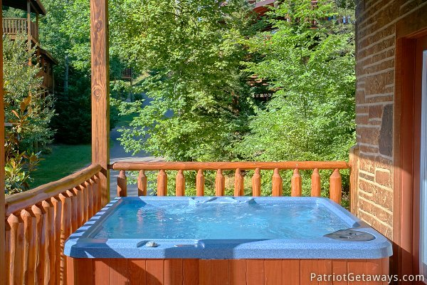 Outdoor hot tub at Alpine Sundance Trail, a 3 bedroom cabin rental located in Pigeon Forge