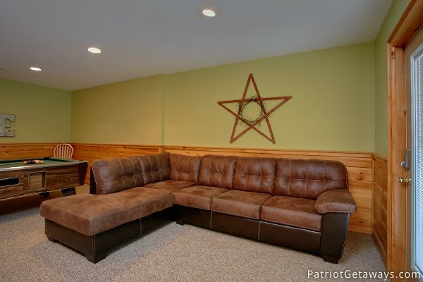 Large sectional sofa in the game room at Alpine Sundance Trail, a 3 bedroom cabin rental located in Pigeon Forge