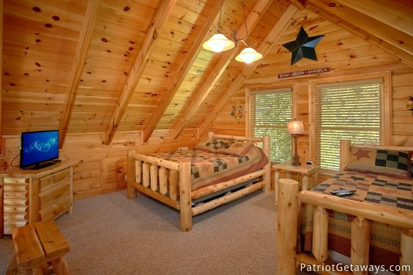 Lofted bedroom with two queen beds at Alpine Sundance Trail, a 3 bedroom cabin rental located in Pigeon Forge