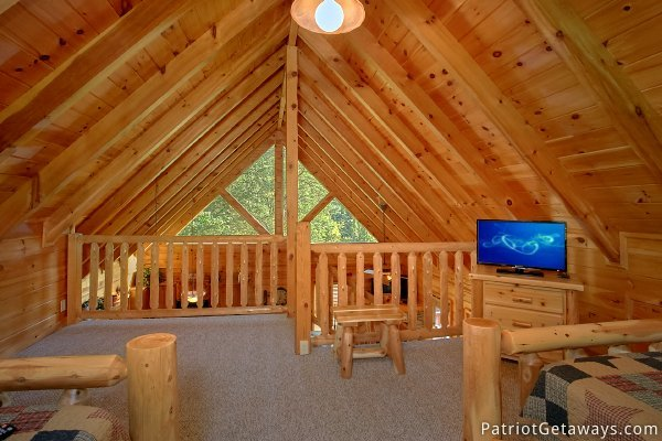 Looking out from the lofted bedroom at Alpine Sundance Trail, a 3 bedroom cabin rental located in Pigeon Forge