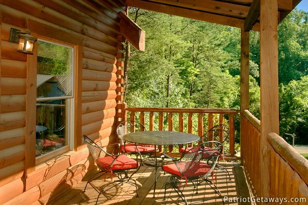 Outdoor patio furniture at Alpine Sundance Trail, a 3 bedroom cabin rental located in Pigeon Forge
