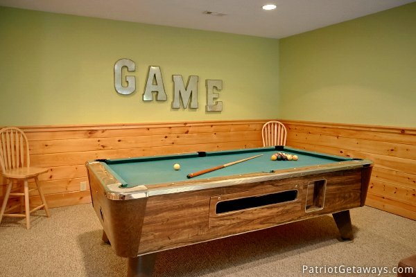 Green felted pool table in the game room at Alpine Sundance Trail, a 3 bedroom cabin rental located in Pigeon Forge