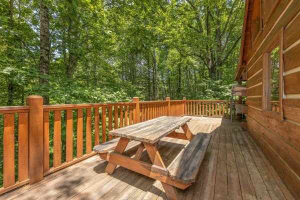 Picnic table on the deck at Bootlegger Hill Hideaway, a 2 bedroom cabin rental located in Pigeon Forge