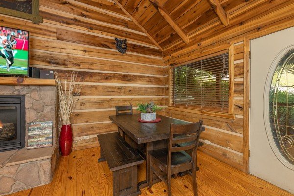 DIning table for six in the living room at Bootlegger Hill Hideaway, a 2 bedroom cabin rental located in Pigeon Forge