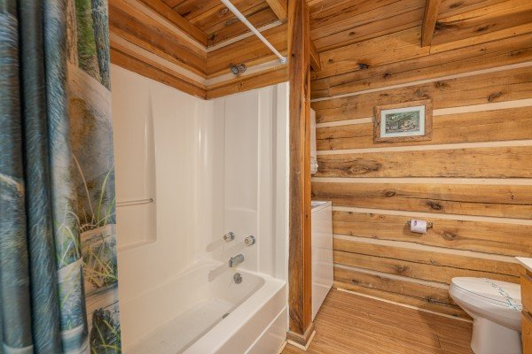 Bathroom with tub and shower at Bootlegger Hill Hideaway, a 2 bedroom cabin rental located in Pigeon Forge
