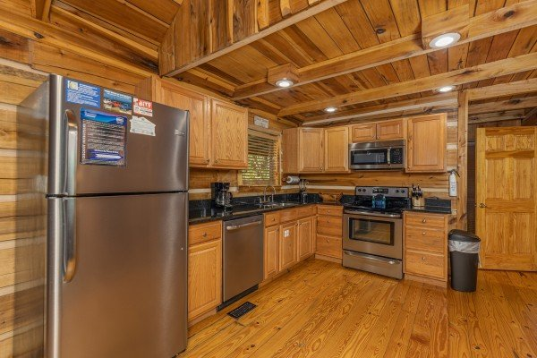 Kitchen with stainless appliances at Bootlegger Hill Hideaway, a 2 bedroom cabin rental located in Pigeon Forge