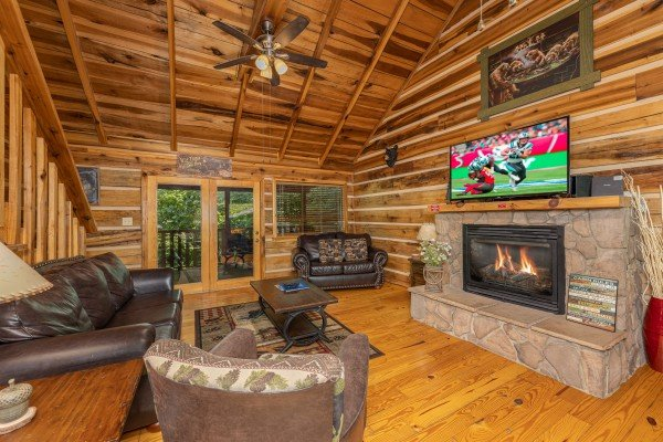 Living room with fireplace and TV at Bootlegger Hill Hideaway, a 2 bedroom cabin rental located in Pigeon Forge