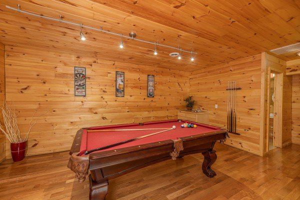 Red felt pool table at Bootlegger Hill Hideaway, a 2 bedroom cabin rental located in Pigeon Forge