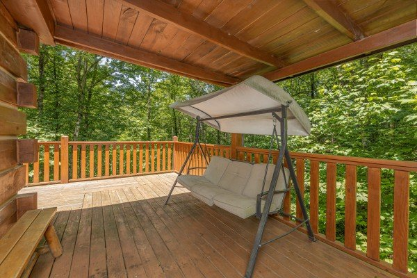 Porch swing at Bootlegger Hill Hideaway, a 2 bedroom cabin rental located in Pigeon Forge
