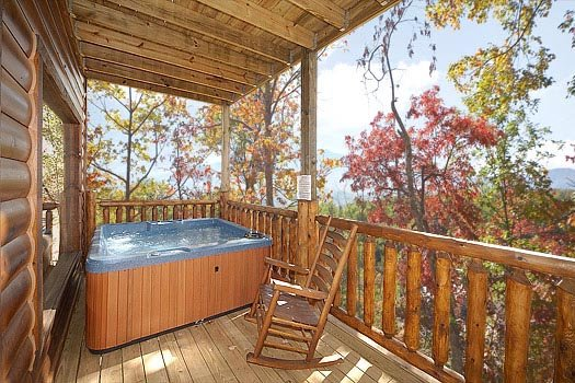 Covered deck with hot tub at Summit View, a 3 bedroom cabin rental located in Gatlinburg