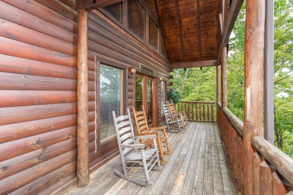Rocking chairs on a covered deck at Summit View, a 3 bedroom cabin rental located in Gatlinburg