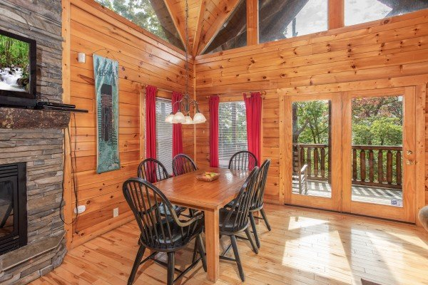 Dining space with seating for 6 at Summit View, a 3 bedroom cabin rental located in Gatlinburg