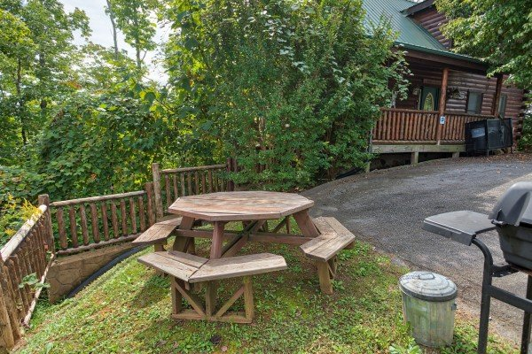 Picnic table and grill off the driveway at Summit View, a 3 bedroom cabin rental located in Gatlinburg