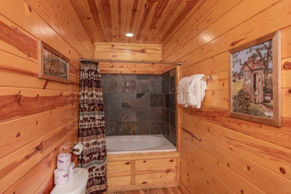 Bathroom with a jacuzzi and shower at Summit View, a 3 bedroom cabin rental located in Gatlinburg