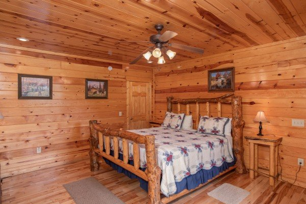 Bedroom with a log bed at Summit View, a 3 bedroom cabin rental located in Gatlinburg