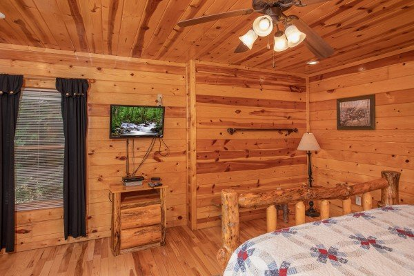 Bedroom with a TV and night stand at Summit View, a 3 bedroom cabin rental located in Gatlinburg