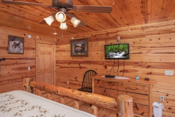 Dresser, TV, and chair in the first floor bedroom at Summit View, a 3 bedroom cabin rental located in Gatlinburg