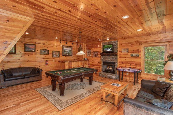 Game room with a pool table, fireplace, TV, and sofa at Summit View, a 3 bedroom cabin rental in Gatlinburg
