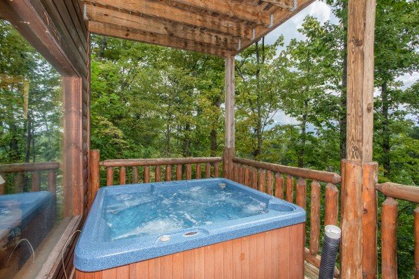 Close up of a hot tub on a covered deck at Summit View, a 3 bedroom cabin rental located in Gatlinburg