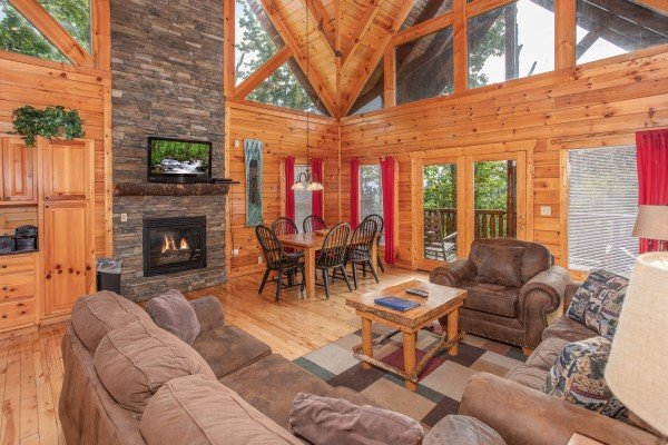 Living room and dining space on the main floor at Summit View, a 3 bedroom cabin rental located in Gatlinburg