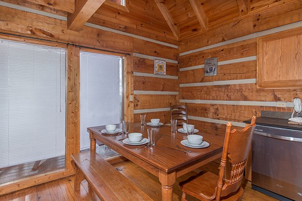Dining table in the kitchen with seating for five at Ella-vation, a 3-bedroom cabin rental located in Gatlinburg