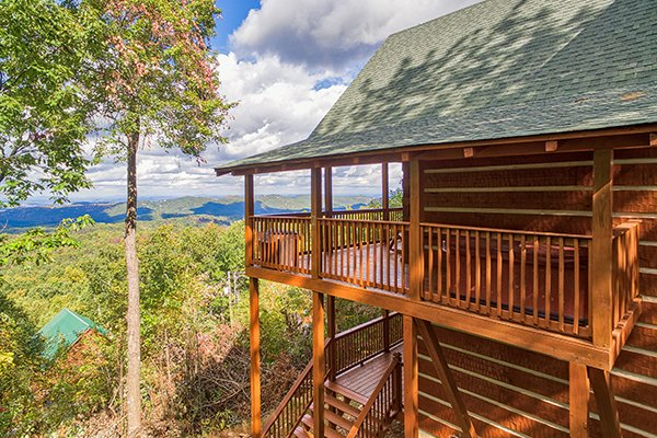Looking at the cabin and beyond to the views at Ella-vation, a 3-bedroom cabin rental located in Gatlinburg