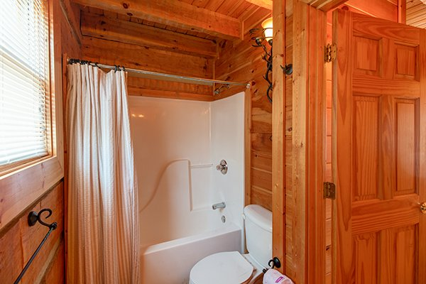 Bathroom with a tub and shower at Ella-vation, a 3-bedroom cabin rental located in Gatlinburg