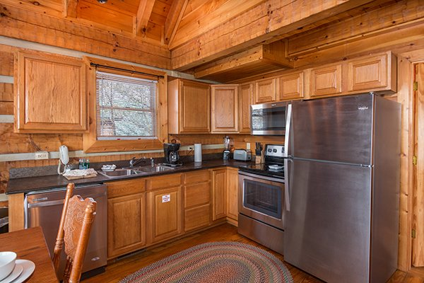 Kitchen with stainless appliances at Ella-vation, a 3-bedroom cabin rental located in Gatlinburg