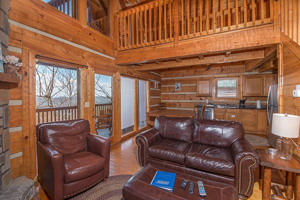 From the living room, looking toward the dining and kitchen areas at Ella-vation, a 3-bedroom cabin rental located in Gatlinburg