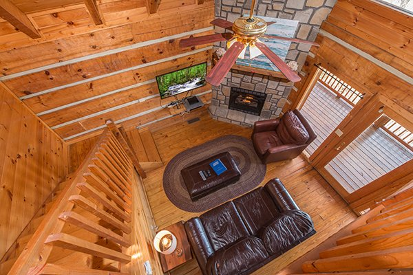 Looking down into the living room from the upper floor at Ella-vation, a 3-bedroom cabin rental located in Gatlinburg