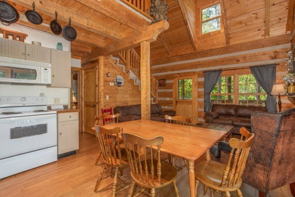 Dining space for six in the open concept main floor at Trillium Lodge, a 4 bedroom cabin rental located in Gatlinburg