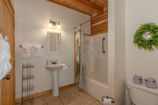 Bathroom with a tub and shower at Trillium Lodge, a 4 bedroom cabin rental located in Gatlinburg