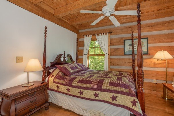 Bedroom with a four-post bed at Trillium Lodge, a 4 bedroom cabin rental located in Gatlinburg