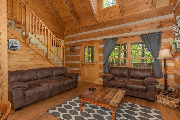 Living room seating at Trillium Lodge, a 4 bedroom cabin rental located in Gatlinburg