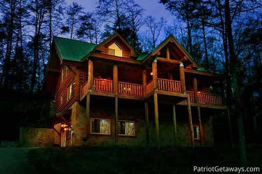 Front exterior at night of A Great Escape, a 4-bedroom cabin rental located in Pigeon Forge