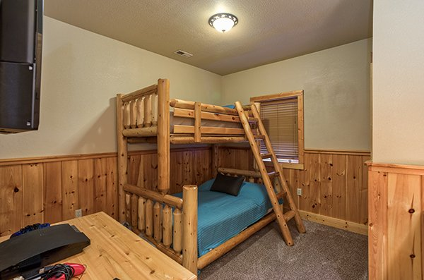 Twin bunk over a full bunk in a bedroom at A Great Escape, a 4-bedroom cabin rental located in Pigeon Forge