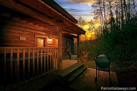 Charcoal grill area off the front porch at A Great Escape, a 4-bedroom cabin rental located in Pigeon Forge