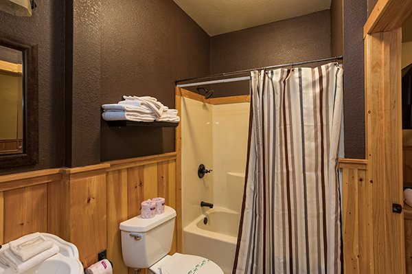 Bathroom with a tub and shower at A Great Escape, a 4-bedroom cabin rental located in Pigeon Forge